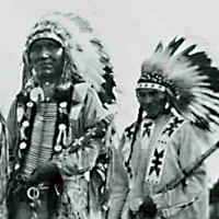 Three Indians in ceremonial regalia