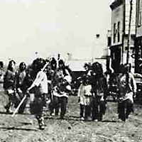 Sioux Dance (probably Wahpeton Dakota) on Main Street, Prince Albert, NWT