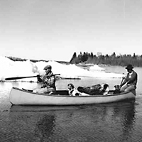Indian Trappers in a canoe - La Ronge, SK