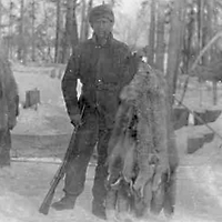 A fur trapper with his catch. near Fort Resolution, NWT