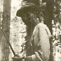 Cree Hunter Standing by Tree
