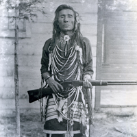 Atimoyoo: an armed man in traditional dress